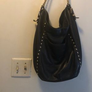 It is a Michael Kors hobo bag.